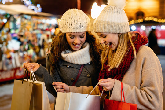 Portrait of cheerful young happy woman doing Christmas shopping. Christmas shopping people concept