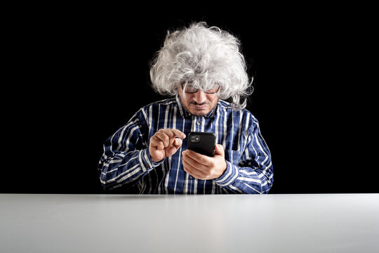 A senior man typical boomer curved on his smartphone