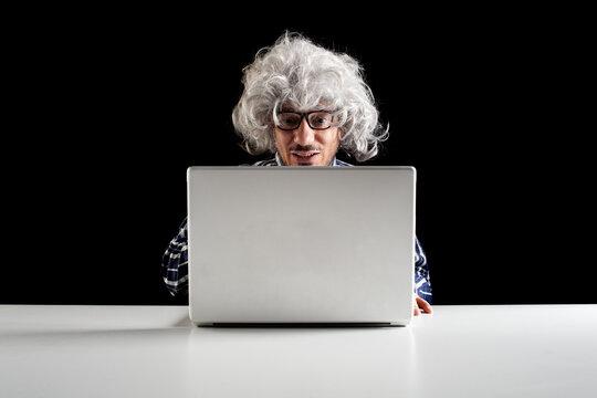 Boomer. Smiling senior man using laptop copy space