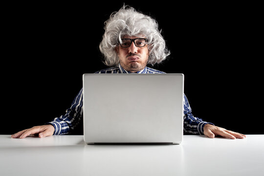 An old man boomer snorting while using computer