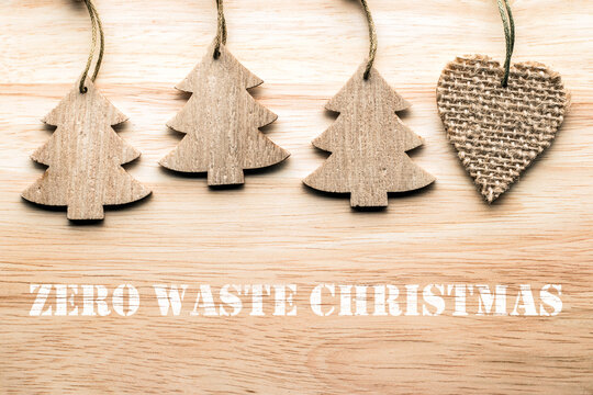 Eco friendly Christmas tree decorations on wooden surface. Handmade craft wooden toys
