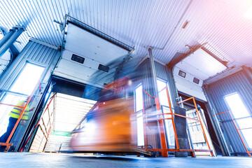 Obraz Forklift loader working at beverages plant warehouse - fototapety do salonu