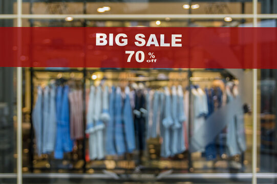 BIG Sale 70% off mock up advertise display frame setting over the Abstract blurred photo of clothing store in a shopping mall, shopping concept