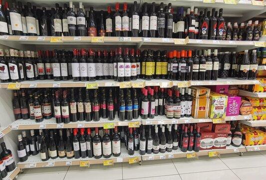 wine cellar in super market shelf many bottles and wines