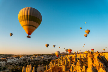 Shot of colorful hot air balloons flying over Goreme national park in Nevsehir, Cappadocia, Turkey