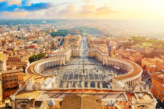 Famous Saint Peter's Square in Vatican and aerial view of the Rome city during sunny day sunset