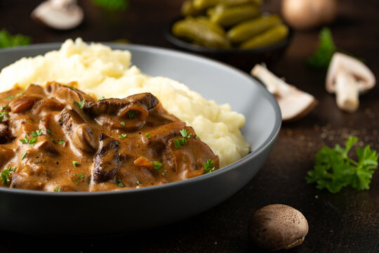 Beef Stroganoff with mushrooms and mashed potatoes.