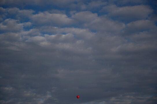 A hot air balloon floats in the sky near Oxford