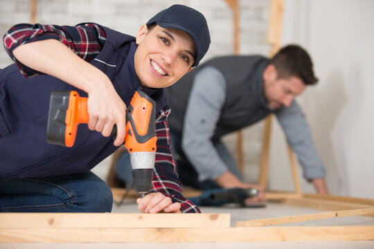 young woman worker in the carpenter workroom