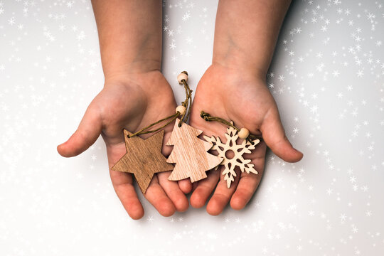 Eco friendly Christmas tree decorations in the hands of a child