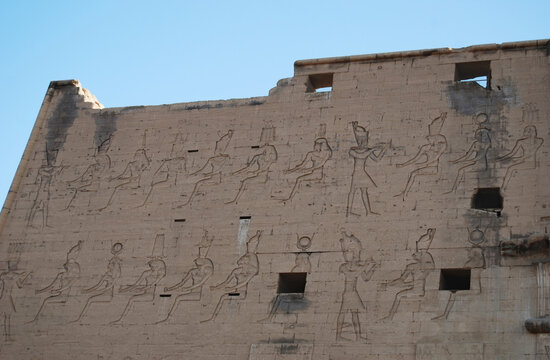 Ancient pillars, hieroglyphics and egyptian statues at the Temple of Edfu. Nubia, Egypt