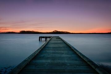 Long exposure sunset by the pier in Strahan, Tasmania, Australia.