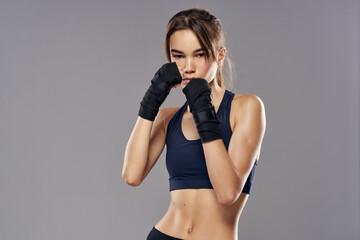 Obraz athletic woman boxing punching workout bandages isolated background - fototapety do salonu