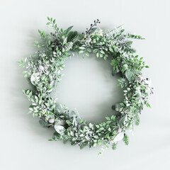 Obraz Christmas composition. Christmas wreath on pastel green background. Flat lay, top view - fototapety do salonu