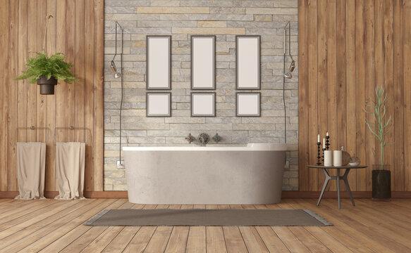 Elegant bathroom with bathtub against stone wall