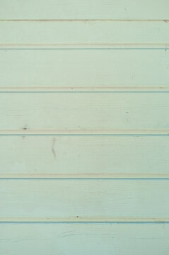 Weathered wooden plank painted in green color