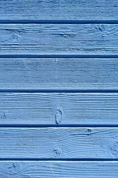 Weathered wooden plank painted in blue color