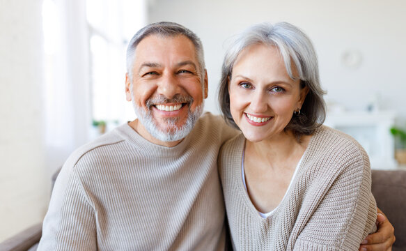 Beautiful smiling senior family couple husband and wife looking at camera with love