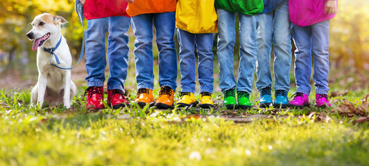 Obraz Colorful kids shoes. Children play outdoor. - fototapety do salonu