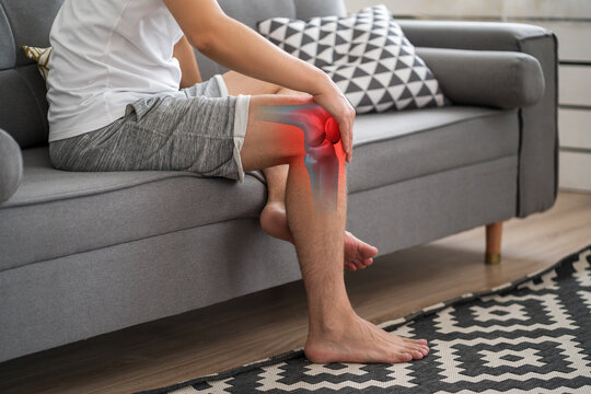 Knee pain, man suffering from osteoarthritis at home