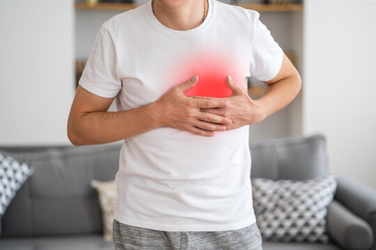 Heart attack, man with chest pain suffering at home