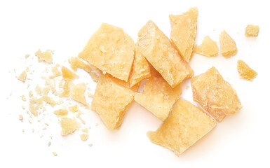 Obraz Pieces of parmesan cheese isolated on white background. Parmesan chunks with crumbs  top view - fototapety do salonu