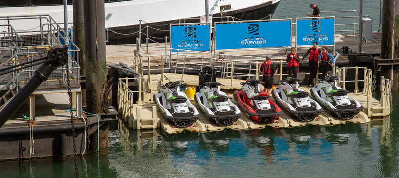 Plymouth, Devon, England, UK. 2021. Powerful jet skis for training and hire on a docking system at Barbican landing stage on Plymouth's waterfront area.