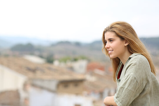 Happy teen looking away from balcony