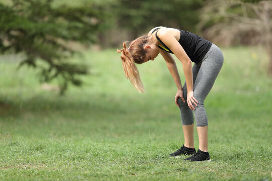 Exhausted runner resting in a park