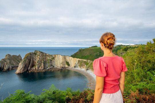 Woman contemplating a beautiful coast