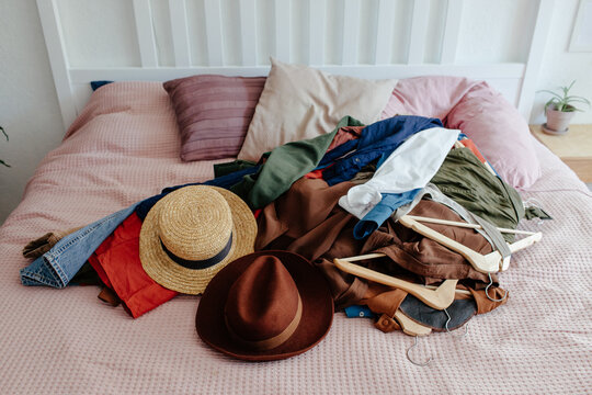 Heap of clothes on bed