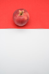 fresh organic agriculture red apple fruit on a red and white surface