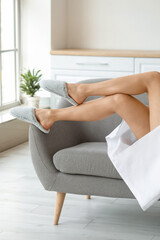 Obraz Young woman with beautiful legs relaxing at home - fototapety do salonu