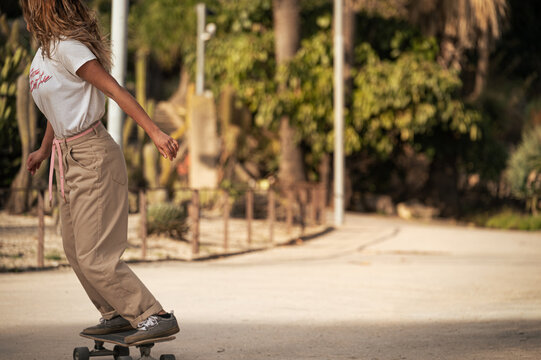 Anonymous skater rides skateboard in a park
