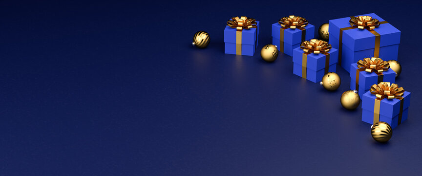 Blue gift boxes with golden ribbon and bow and christmas baubles on a blue stone background. Copy space