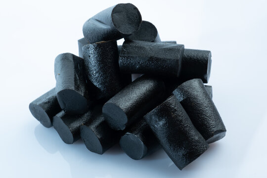 Closeup of a bunch of Finnish black licorice against a bright white background