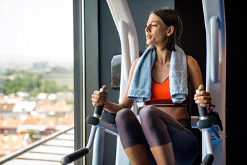 Obraz Portrait of happy fit woman exercise in gym to stay healthy - fototapety do salonu