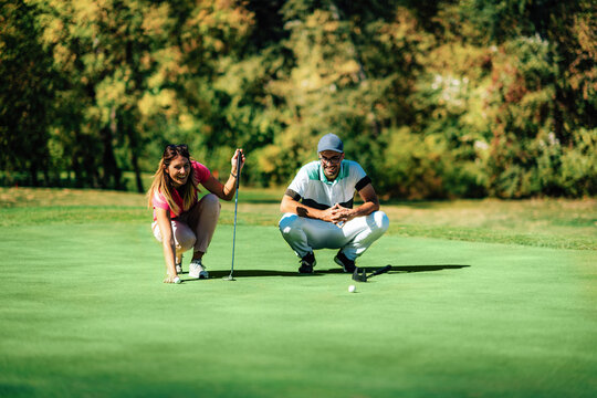 Golf lifestyle. Young couple having fun on the golf course