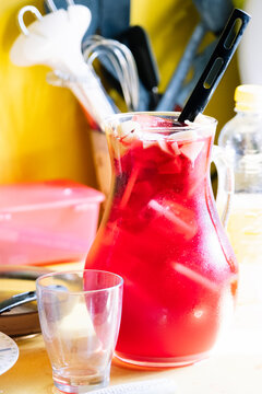 Pitcher of sangria with ice in the kitchen