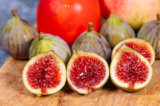 Closeup of figs with pomegranates and persimmons