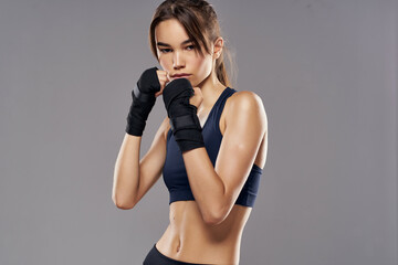 Obraz athletic woman hand bandages punch workout fighter isolated background - fototapety do salonu
