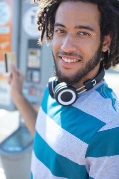 portrait happy smiling man in wireless headphones