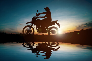 Men's silhouettes and touring motocross bikes. Park to relax in the mountains in the evening. adventure travel and leisure concept