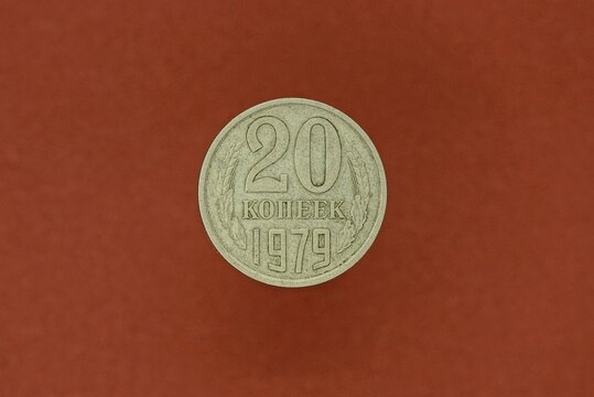 old gray Soviet coin twenty kopecks lying on a brown table