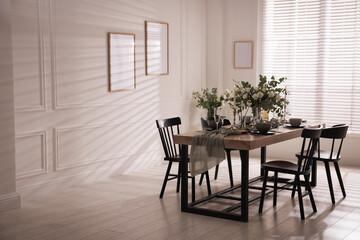 Obraz Festive table setting with beautiful tableware and decor indoors - fototapety do salonu