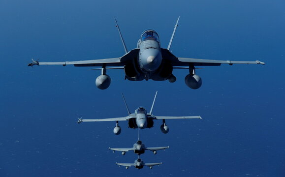 Four fighter aircrafts of the Spanish Air Force are seen in-flight during the Ocean Sky 2021 Military Exercise for advanced air-to-air training in the southern airspace of the Canary Islands