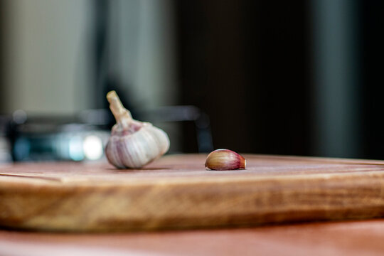 Garlic head on a wooden table. Blurred background. Copy space.