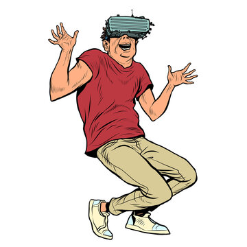 a young man in virtual reality glasses is a joy. Computer technology