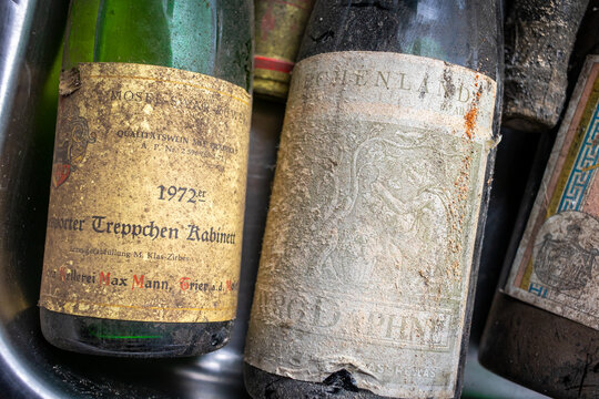 Neckargemuend, Germany - September 11, 2021: very old wine bottles with deposits from long cellar storage as offers at a flea market