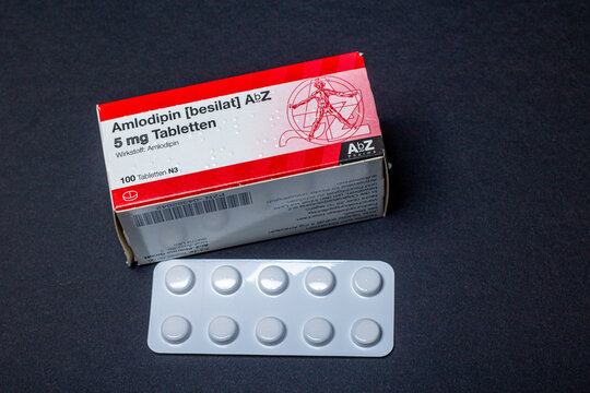 Neckargemuend, Germany: October 06, 2021: Packaging and tablets blister of the prescription drug Amlodipine, a blood pressure-lowering preparation from the group of calcium channel blockers in the dos